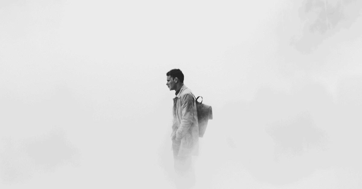 man standing in fog
