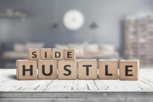 tiles that spell out the word - side hustle