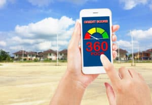 People using smartphone about credit score for buy real estate. On housing blur background.