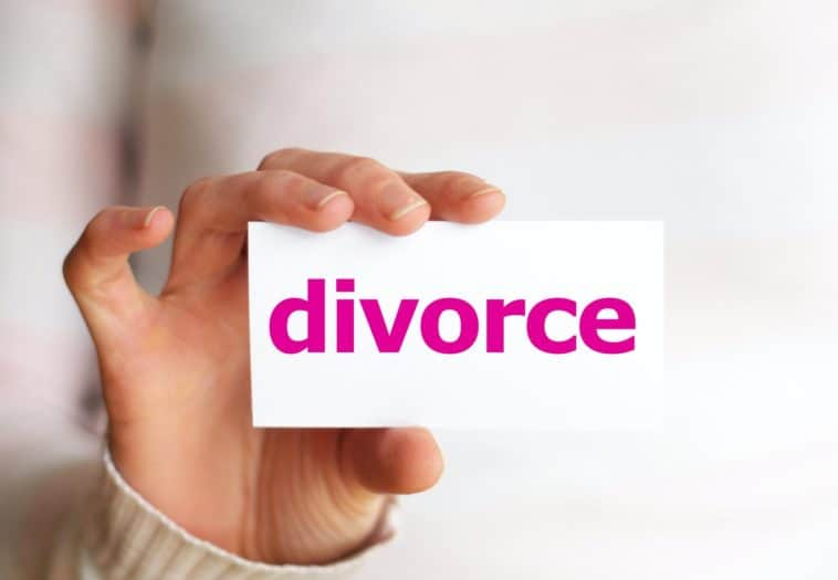 divorce concept with hand holding paper sign