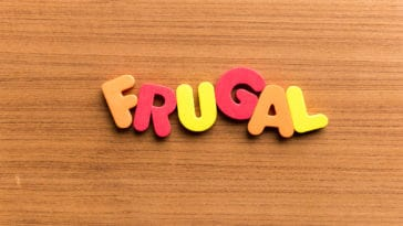frugal colorful word on the wooden background