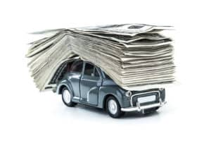 Small decorative car model carries on itself a lot of cash