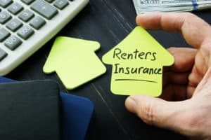 Renters insurance sign on the house shaped sheet. -Does My Landlord's Homeowner's Insurance Policy Cover Me