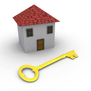 3d house with golden key in front of it