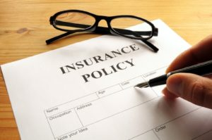 insurance policy form on desk in office