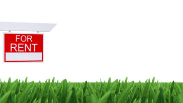 Sign for rent with green grass and white background