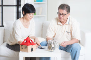 Asian senior couple counting on money -Is 90K a Lot of Money