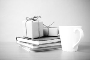 book with gift box and coffee mug on wood background black and white tone style -Is 80K a Lot of Money
