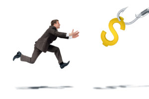 Businessman trying to catch dollar sign isolated on white background