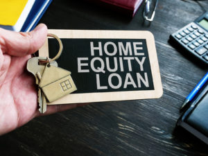 Home Equity Loan sign and key for house.