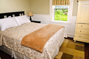 Bedroom interior with comfortable queen size bed with view -Can You Afford an Apartment with a Part-Time Job