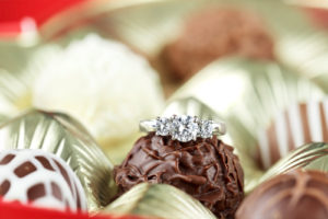 Diamond engagement inside of a box of chocolate truffles -Is 80K a Lot of Money