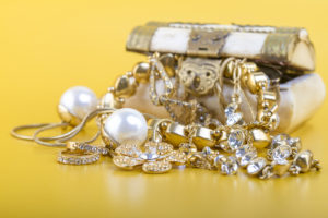 a pile of expensive gold jewlery