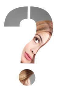 woman looking through question mark