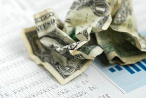 crumpled up one dollar bill