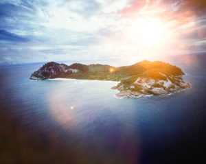 Private island in the ocean with sun shining -Is $800,000 Dollars a Lot of Money