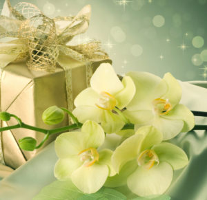 gold wrapped gift and some flowers Is $400,000 Dollars a Lot of Money