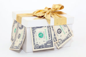 expensive white gift box with gold ribbon and bow and dollars Is $3,000,000 Dollars a Lot of Money