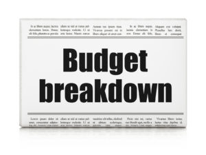 newspaper headline Budget Breakdown on White background