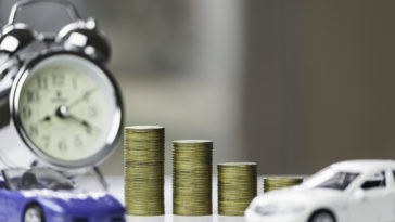 Line graph with stack of coins and toy car