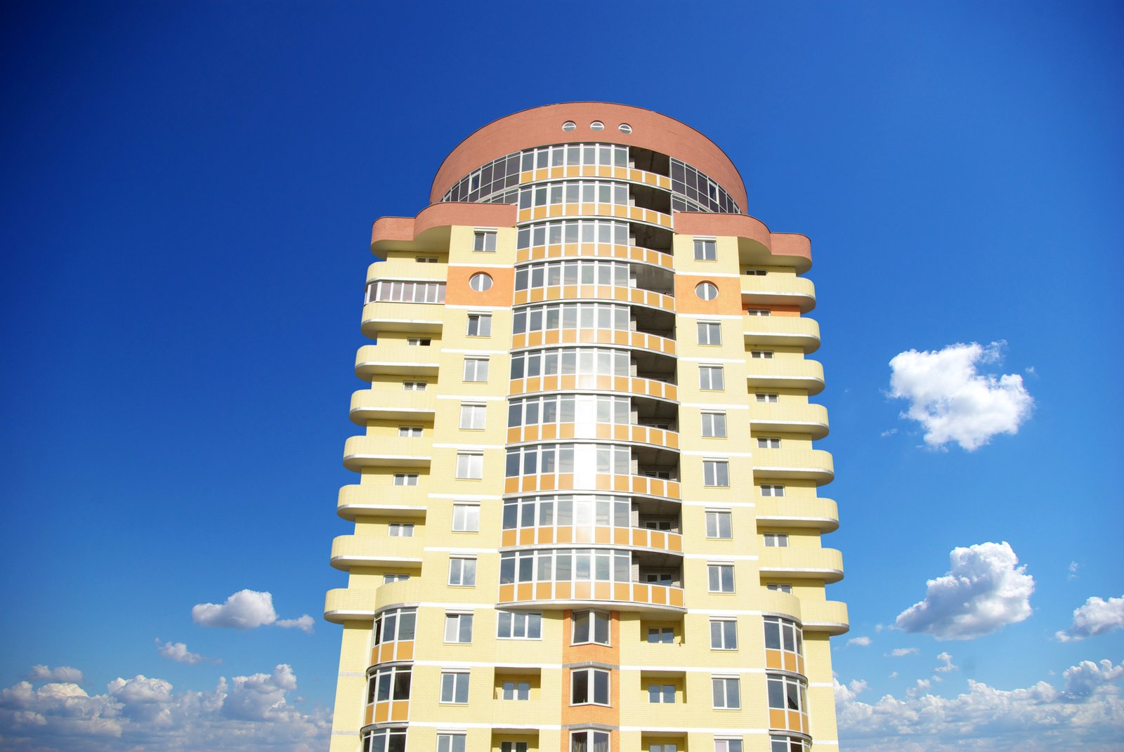 a modern apartment building against the sky