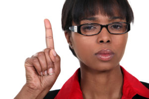 black woman with finger in the air